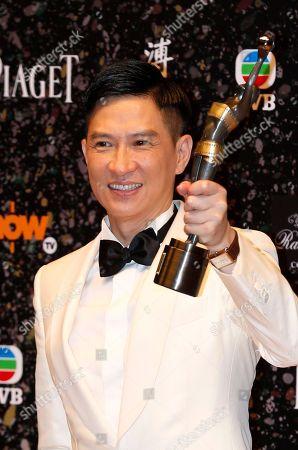 """Nick Cheung Ka-fai Hong Kong actor Nick Cheung Ka-fai poses after winning the Best Actor award for his movie """"Unbeatable"""" at the 33rd Hong Kong Film Awards in Hong Kong"""
