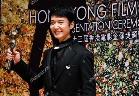 """Stock Photo of Babyjohn Choi Hong Kong actor Babyjohn Choi poses after winning the Best New Performer of his movie """"The Way We Dance"""" at the 33rd Hong Kong Film Awards in Hong Kong"""