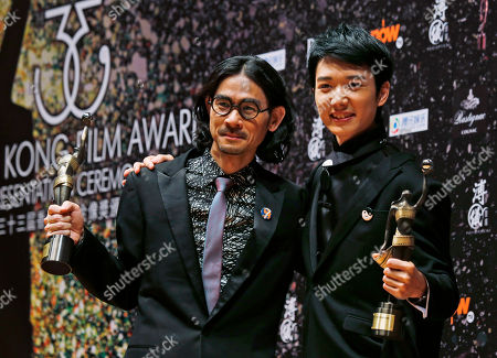 """Stock Picture of Adam Wong, Babyjohn Choi Hong Kong director Adam Wong, left, and actor Babyjohn Choi pose after winning the Best New Director award and the Best New Performer of their movie """"The Way We Dance"""" at the 33rd Hong Kong Film Awards in Hong Kong"""
