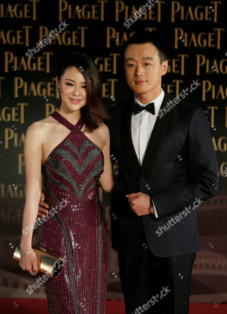 Tong Dawei, Guan Yue Chinese actor Tong Dawei and his wife Guan Yue pose on the red carpet of the 33rd Hong Kong Film Awards in Hong Kong