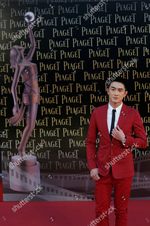 Stock Photo of Chinese actor Kenny Lin poses on the red carpet of the 33rd Hong Kong Film Awards in Hong Kong