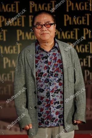 Fruit Chan Hong Kong director Fruit Chan poses on the red carpet of the 33rd Hong Kong Film Awards in Hong Kong