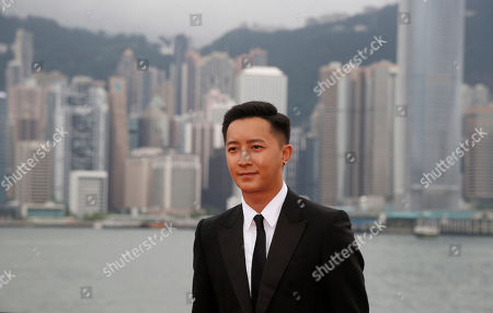 "Han Geng Chinese singer and actor Han Geng poses on the red carpet as he arrives for the world premiere of the movie ""Transformers 4: Age of Extinction"" in Hong Kong . The latest installment in the blockbuster series of ""Transformers"" films is making its world premier not in the usual entertainment hubs of Los Angeles or New York but in the wealthy Chinese metropolis of Hong Kong, the latest sign of Hollywood's increasing focus on China's booming film market"