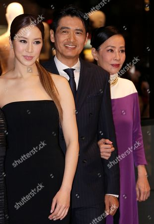 Cathy Chui, Chow Yun-fat, Jasmine Tan From left, Cathy Chui, left, daughter-in-law of Lee Shau-kee, Chairman of Henderson Land Development Company Limited, Hong Kong actor Chow Yun-fat and his wife Jasmine Tan pose for photographers during the opening ceremony of Hugo Boss store in Hong Kong