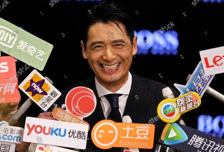 Chow Yun-fat Hong Kong actor Chow Yun-fat smiles during interview at the opening ceremony of Hugo Boss store in Hong Kong
