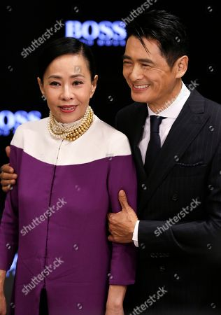 Chow Yun-fat, Jasmine Tan Hong Kong actor Chow Yun-fat and his wife Jasmine Tan pose for photographers during the opening ceremony of Hugo Boss stores in Hong Kong