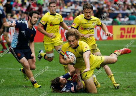 Jesse Parahi, Terry Bouhraoua Australia's Jesse Parahi, center, is tackled by France's Terry Bouhraoua, on the ground, during the second day match of the Hong Kong Sevens rugby tournament in Hong Kong, . Australia won 26-0