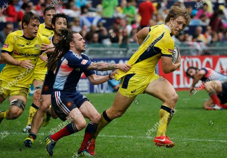 Jesse Parahi, Terry Bouhraoua Australia's Jesse Parahi, right, is tackled by France's Terry Bouhraoua during the second day match of the Hong Kong Sevens rugby tournament in Hong Kong, . Australia won 26-0
