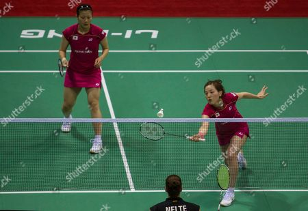 Miyuki Maeda, Reika Kakiiwa Japan's Miyuki Maeda, left, watches teammate Reika Kakiiwa, right, return a shot against Germany's Carla Nelte and Johann Goliszewski during their women's doubles event of the Uber Cup Badminton in New Delhi, India