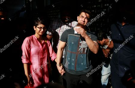 Aamir Khan, Kiran Rao Bollywood actor Aamir Khan, walks with his wife Kiran Rao, left after casting their vote during the sixth phase of polling of the Indian parliamentary elections in Mumbai, India, .The multiphase voting across the country runs until May 12, with results for the 543-seat lower house of parliament expected on May 16