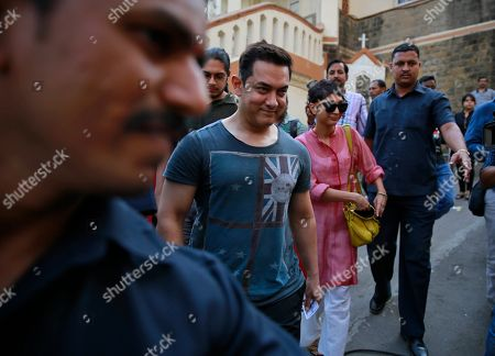 Aamir Khan, Kiran Rao Bollywood actor Aamir Khan, center, arrives with his wife Kiran Rao to cast their vote during the sixth phase of polling of the Indian parliamentary elections in Mumbai, India, .The multiphase voting across the country runs until May 12, with results for the 543-seat lower house of parliament expected on May 16