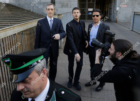 Silvio Berlusconi's lawyer Niccolo' Ghedini arrives at the court in Milan, Italy, . A Milan court holds a hearing to determine how Silvio Berlusconi will serve his tax fraud sentence. The options include community service and house arrest. The court has five days to issue a decision