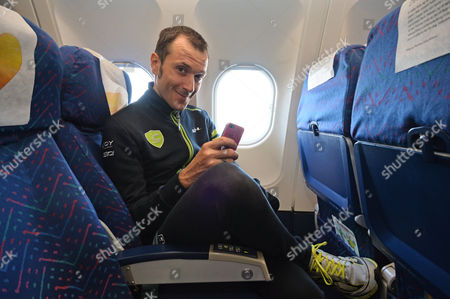 Italy's Ivan Basso smiles during the flight transferring Giro d' Italia, Tour of Italy cyclists, from Dublin, Ireland, to Bari, Italy, . After three wet days in Northern Ireland and Ireland, the Giro takes a rest day on Monday as it travels back to Italy. The race resumes with another mainly flat stage, which should again end in a bunch sprint in Bari. The Giro ends in Trieste on June 1