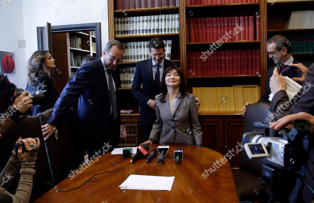 Kazakh dissident Mukhtar Ablyazov's wife Alma Shalabayeva, center, is helped sit by Peter Sahlas, the US lawyer representing Mukhtar Ablyazov, as they arrive for a press conference in Rome, Thursday, April 2014. Shalabayeva has arrived in Italy on Dec. 2013, with her young daughter seven months after they were improperly deported back to Kazakhstan in a case that fueled tensions in Italy