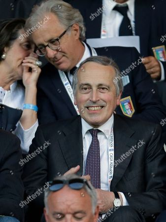 Italian soccer federation president Giancarlo Abete follows the game from the stands during a friendly World Cup preparation soccer match between Italy and Luxembourg in Perugia, Italy, . Italy opens its Brazilian World Cup campaign against England in Group D on June 14 then faces Costa Rica on June 20 and Uruguay on June 24