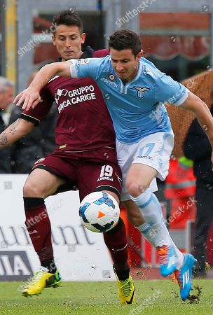 Lazio's Bruno Pereirinha, right, and Livoprn's Leandro Greco vie for the ball during their Serie A soccer match in Leghorn, Italy