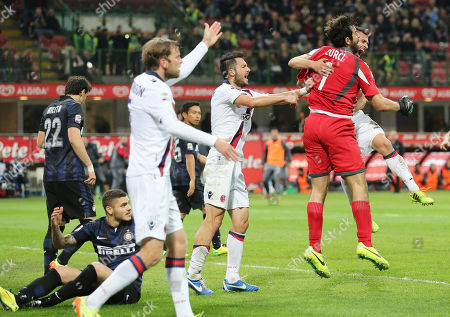 Bologna goalkeeper Gianluca Curci, right, celebrates with his teammates after saving a penalty kick shot by Inter Milan forward Diego Milito during the Serie A soccer match between Inter Milan and Bologna at the San Siro stadium in Milan, Italy