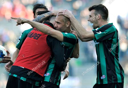 Sassuolo's Simone Zaza, center, celebrates with his teammate Alessandro Longhi after scoring against Catania during their Italian Serie A soccer match at Mapei stadium in Reggio Emilia, Italy