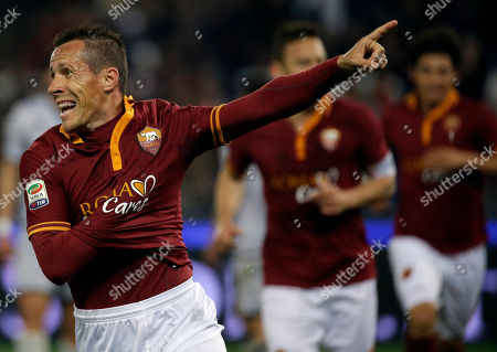 Roma's Rodrigo Taddei celebrates after scoring during a Serie A soccer match between Roma and Atalanta in Rome's Olympic stadium