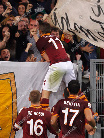 Rodrigo Taddei Roma midfielder Rodrigo Taddei, of Brazil, top, celebrates with teammates and fans after scoring during a Serie A soccer match between Roma and Parma, at Rome's Olympic stadium