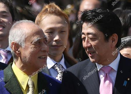 Shinzo Abe, Masahiko Tsugawa Japanese Prime Minister Shinzo Abe, right, speaks with Japanese actor Masahiko Tsugawa, left, during a cherry blossom viewing party hosted by Abe at Tokyo's Shinjuku Gyoen National Garden