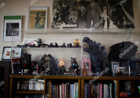 """Stock Picture of Collection of mementos about Godzilla are displayed in a showcase as original suit actor Haruo Nakajima, who has played his role as the monster, at his home in Sagamihara, near Tokyo. """"It's not some cowboy movie,"""" Nakajima, 85, said proudly, sitting among sepia-toned photos of him as a young man and Godzilla figures in his apartment. """"Everyone asks me to play Godzilla again,"""" he said. """"My Godzilla was the best"""