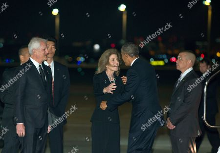 Barack Obama, Caroline Kennedy, Edwin Schlossberg President Barack Obama is greeted by U.S. Ambassador to Japan Caroline Kennedy and her husband Edwin Schlossberg, left, as he arrives on Air Force One at Haneda International Airport in Tokyo, as he begins a four-country trip through the Asia-Pacific region