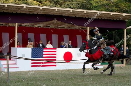 Barack Obama, Edwin Schlossberg, Caroline Kennedy, Susn Rice, Seitaro Nakajima President Barack Obama watches a Yabusame or horseback archery demonstration as he tours Meiji Shrine in Tokyo, . Also watching are National Security Advisor Susan Rice, left, Seitaro Nakajima the shrine's chief priest, fourth from left, and U.S. Ambassador to Japan Caroline Kennedy and her husband Edwin Schlossberg at right. Showing solidarity with Japan, Obama affirmed Thursday that the U.S. would be obligated to defend Tokyo in a confrontation with Beijing over a set of disputed islands, but urged all sides to resolve the long-running dispute peacefully