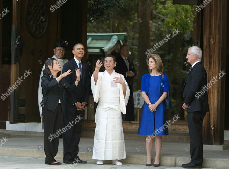 Barack Obama, Edwin Schlossberg, Caroline Kennedy, Seitaro Nakajima President Barack Obama tours Meiji Shrine in Tokyo, . Also on the tour with the president are chief priest Seitaro Nakajima, U.S. Ambassador to Japan Caroline Kennedy and her husband Edwin Schlossberg. Showing solidarity with Japan, Obama affirmed Thursday that the U.S. would be obligated to defend Tokyo in a confrontation with Beijing over a set of disputed islands, but urged all sides to resolve the long-running dispute peacefully