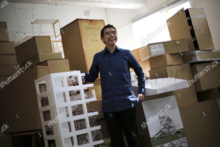 Sou Fujimoto Japanese architect Sou Fujimoto stands next to a scale model of a building he designed at his office in Tokyo