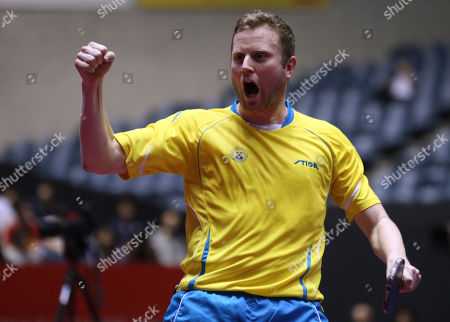 Jens Lundqvist Jens Lundqvist of Sweden celebrates his victory after his best eight playoff match of the World Team Table Tennis Championships against Yang Zi of Singapore in Tokyo