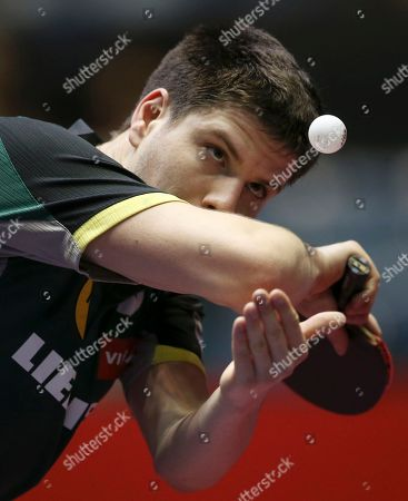 Dimitrij Ovtcharov Dimitrij Ovtcharov of Germany serves against Yang Zi of Singapore during the first round of their World Team Table Tennis Championships in Tokyo
