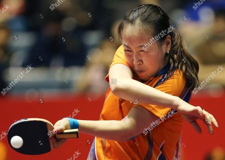 Li Jiao Li Jiao of the Netherlands competes against Huang Yi-Hua of Taiwan during her best eight playoff match of the World Team Table Tennis Championships in Tokyo