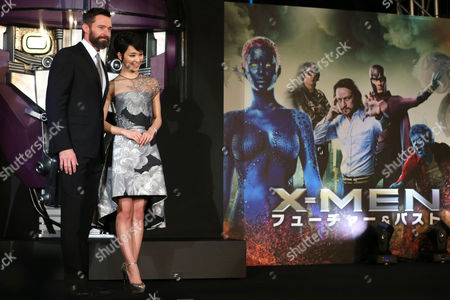 Hugh Jackman, Ayame Goriki Australian actor Hugh Jackman who plays Wolverine, left, and Japanese actress Ayame Goriki, right, who does Japanese stand-in for Mystique in the Japanese version of the movie poses for photographers during an event for the Japan Premiere of X-Men Days Of Future Past in Tokyo