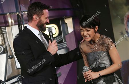 Hugh Jackman, Ayame Goriki Australian actor Hugh Jackman who plays Wolverine, left, jokes with Japanese actress Ayame Goriki, right, who does Japanese stand-in for Mystique in the Japanese version of the movie, during the Japan Premiere of X-Men Days Of Future Past in Tokyo