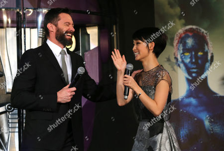 Hugh Jackman, Ayame Goriki Australian actor Hugh Jackman who plays Wolverine, left, and Japanese actress Ayame Goriki, right, who does Japanese stand-in for Mystique in the Japanese version of the movie chat during an event for the Japan Premiere of X-Men Days Of Future Past in Tokyo