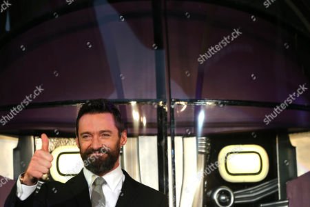 Hugh Jackman, Ayame Goriki Australian actor Hugh Jackman who plays Wolverine gestures during an event for the Japan Premiere of X-Men Days Of Future Past in Tokyo