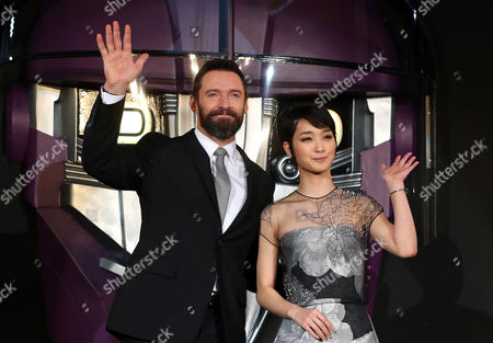 Hugh Jackman, Ayame Goriki Australian actor Hugh Jackman who plays Wolverine, left, and Japanese actress Ayame Goriki, right, who does Japanese stand-in for Mystique in the Japanese version of the movie wave during an event for the Japan Premiere of X-Men Days Of Future Past in Tokyo