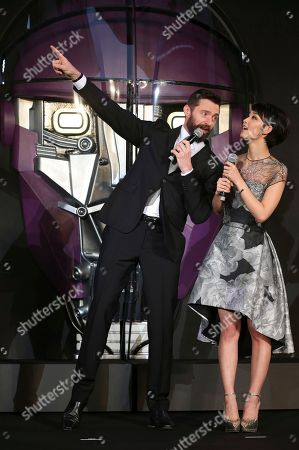 Hugh Jackman, Ayame Goriki Australian actor Hugh Jackman who plays Wolverine, left, and Japanese actress Ayame Goriki, right, who does Japanese stand-in for Mystique in the Japanese version of the movie, chat during the Japan Premiere of X-Men Days Of Future Past in Tokyo