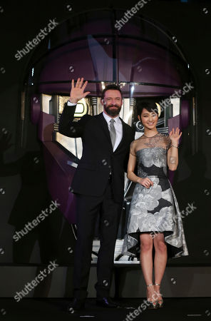 Hugh Jackman, Ayame Goriki Australian actor Hugh Jackman who plays Wolverine, left, and Japanese actress Ayame Goriki, right, who does Japanese stand-in for Mystique in the Japanese version of the movie pose for photographers during the Japan Premiere of X-Men Days Of Future Past in Tokyo