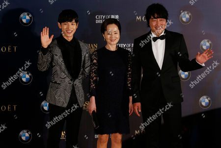 Stock Picture of Song Kang-ho, Kim Young-ae, Im Si-wan From right, South Korea actor Song Kang-ho, actress Kim Young-ae and actor Im Si-wan poses on the red carpet of the Asian Film Awards in Macau