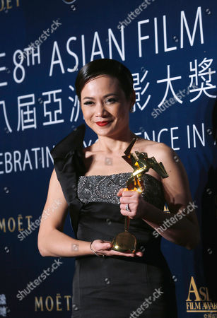 "Yeo Yann Yann Malaysian actress Yeo Yann Yann celebrates after winning the Best Supporting Actress for the movie ""Ilo Ilo"" of the Asian Film Awards in Macau"