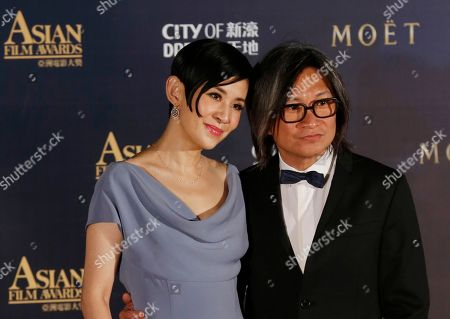Peter Chan, Sandra Ng Hong Kong director Peter Chan, right, poses with his wife Sandra Ng, on the red carpet of the Asian Film Awards in Macau