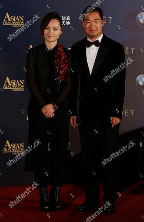 Zhou Bichang, Zhang Guo-li Chinese singer Zhou Bichang, left and actor Zhang Guo-li pose on the red carpet of the Asian Film Awards in Macau