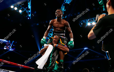 """Nicholas Walters Nicholas """"The Axe Man"""" Walters of Jamaica celebrates after winning the WBA World Featherweight Title boxing match against Vic """"Raging Bull"""" Darchinyan of the U.S. in Macau"""