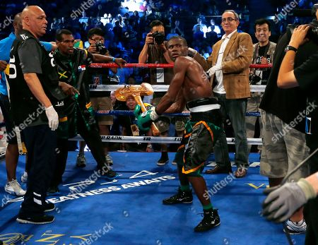 """Nicholas Walters Nicholas """"The Axe Man"""" Walters of Jamaica celebrates after winning the WBA World Featherweight Title boxing match against Vic """"Raging Bull"""" Darchinyan of U.S. in Macau"""