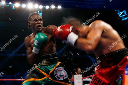 """Nicholas Walters, Vic Darchinyan Nicholas """"The Axe Man"""" Walters of Jamaica left, exchanges punches with Vic """"Raging Bull"""" Darchinyan of U.S. during the WBA World Featherweight Title boxing match in Macau"""