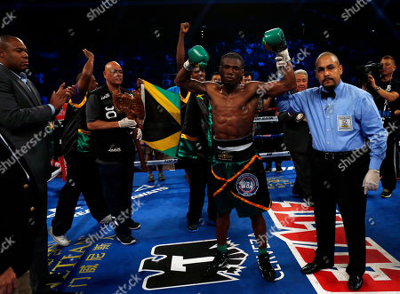 """Nicholas Walters Nicholas """"The Axe Man"""" Walters of Jamaica, second right, celebrates after winning the WBA World Featherweight Title boxing match against Vic """"Raging Bull"""" Darchinyan of U.S. in Macau"""