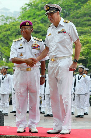 Vice Admiral Ray Griggs, Abdul Aziz Jaafar Chief of the Royal Australian Navy, Vice Admiral Ray Griggs, right, shakes hand with Malaysian Chief of Navy Abdul Aziz Jaafar after inspecting a guard of honor at the Ministry of Defense in Kuala Lumpur, Malaysia, . Vice Adm. Griggs is on a four-day official visit to Malaysia