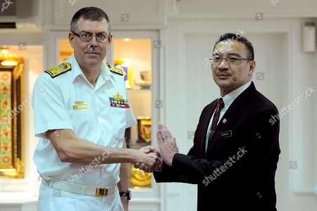 Stock Image of Vice Admiral Ray Griggs, Hishammuddin Hussein Chief of the Royal Australian Navy, Vice Adm. Ray Griggs, left, and Malaysian Defense Minister Hishammuddin Hussein shake hands prior to a meeting at the Ministry of Defense in Kuala Lumpur, Malaysia, . Griggs is on a four-day official visit to Malaysia